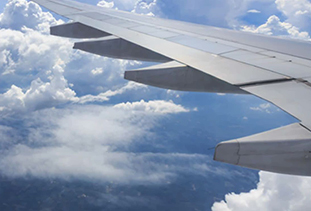 Aircraft Cabin Window View Of Clouds & Wing